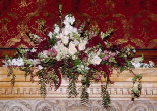 A mantle bouquet in red, pink, and white
