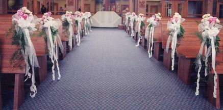 Pink and white aisle decorations