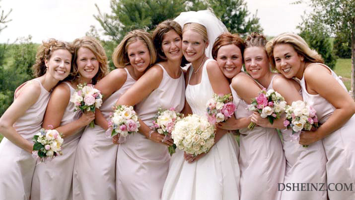 Happy bride with attendants and their bouquets