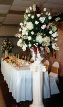 Altar bouquets frame the receptoin head table